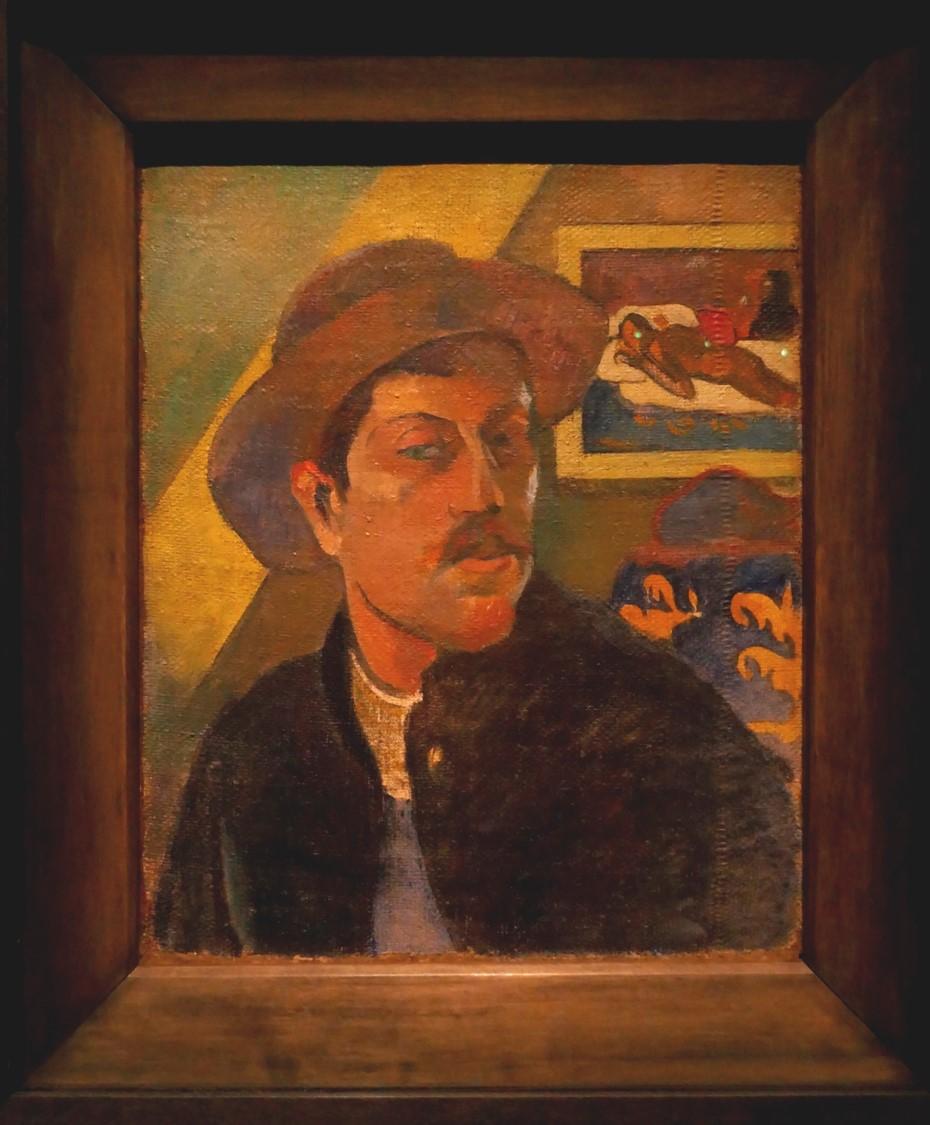 Gauguin Autoportrait au chapeau (1894) motifs tahitiens en arrière-plan